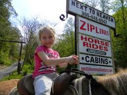 Little girl on horse - NEXT TO HEAVEN ZIPLINES - THE MOST SCENIC ZIPLINE IN THE SMOKIES!
