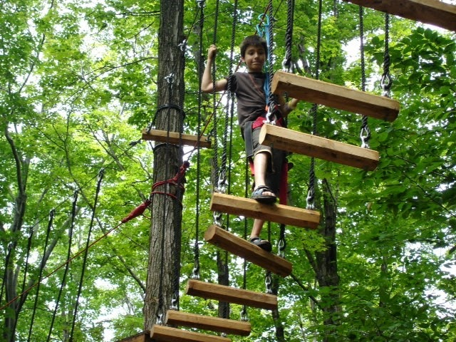 Boy climbing wooden ladder - ADVENTURE PARK IN SEVIERVILLE OFFERS FUN AND SMILES - DAY AND NIGHT!