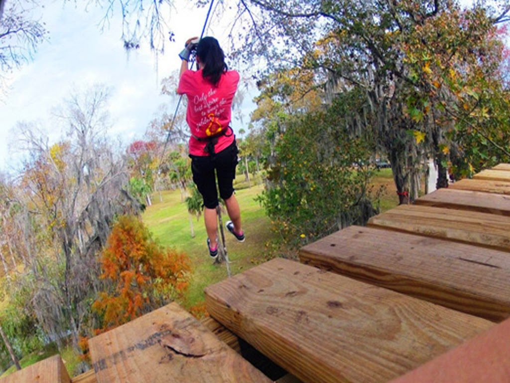 Woman off of ramp 1024x768 - ADVENTURE PARK IN SEVIERVILLE OFFERS FUN AND SMILES - DAY AND NIGHT!
